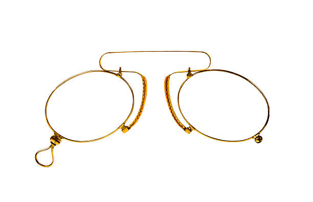 Verres or (pince-nez) sur blanc. - Photo