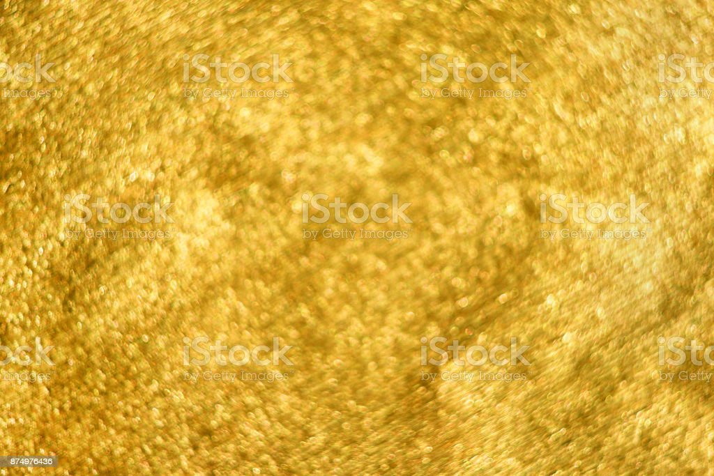 Golden glitter abstract festive background with blur bokeh stock photo