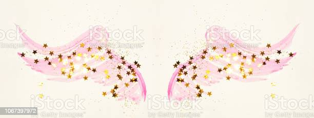 Golden glitter and glittering stars on abstract pink watercolor wings picture id1067397972?b=1&k=6&m=1067397972&s=612x612&h=gzbtzcygforf3b4fhe3kxjj7vccaswrwqykewo2psri=