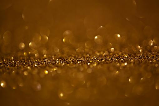 977706014 istock photo Golden Glitter Background 1133117775