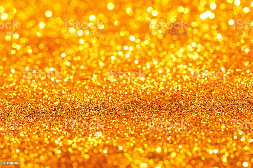 Golden glitter bokeh background stock photo