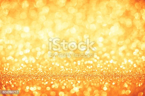 621592540 istock photo Golden glitter defocused lights christmas abstract background 524260717