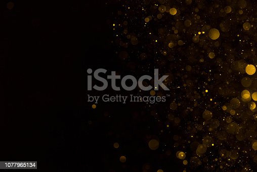 Golden glitter falling sparkle background on black border composition