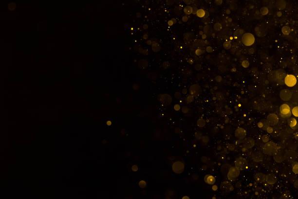złoty brokat spadający blask tła - błyszczący zdjęcia i obrazy z banku zdjęć