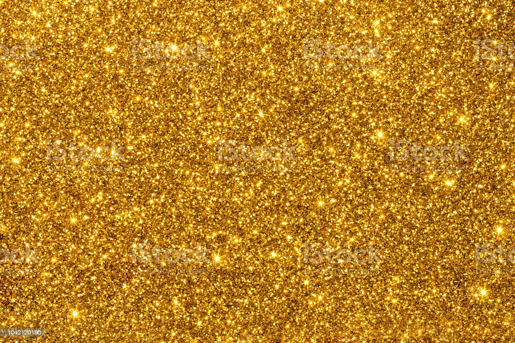 Golden glitter for texture or background stock photo