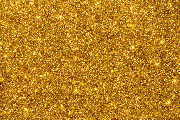 golden glitter for texture or background - scintillante foto e immagini stock