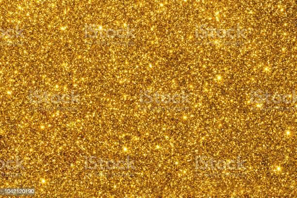 Golden Glitter For Texture Or Background - Fotografie stock e altre immagini di A forma di stella