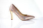 Golden glitter high heel women shoes isolated on white background