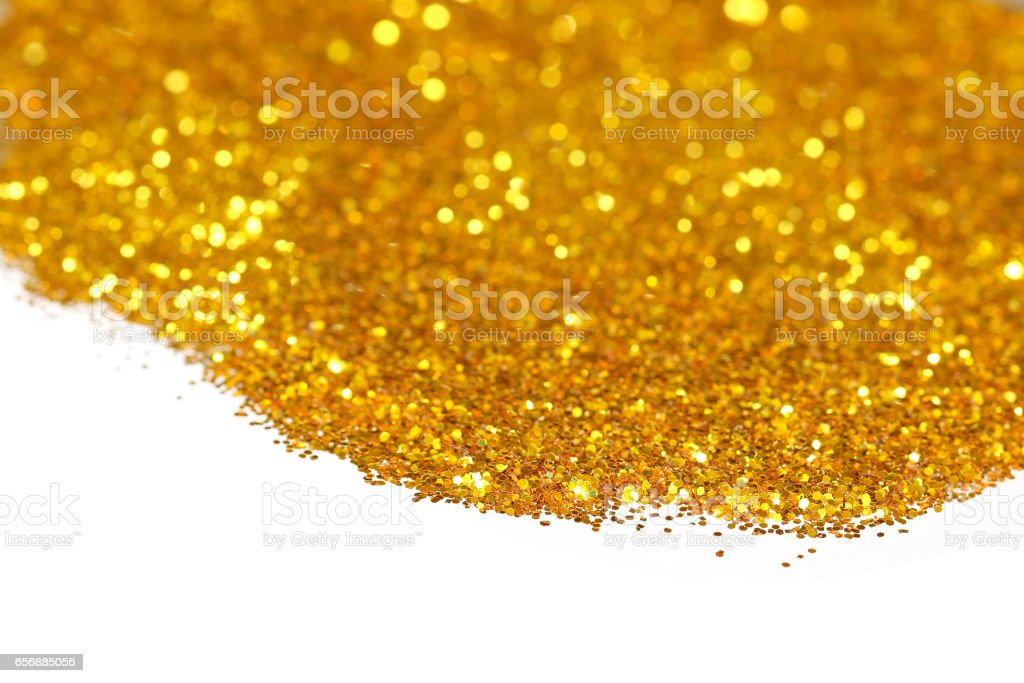 Golden glitter on white background stock photo