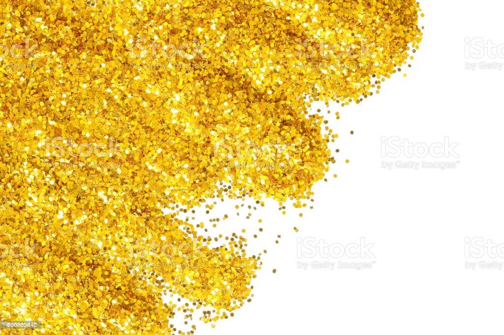 Golden glitter on white background stock photo