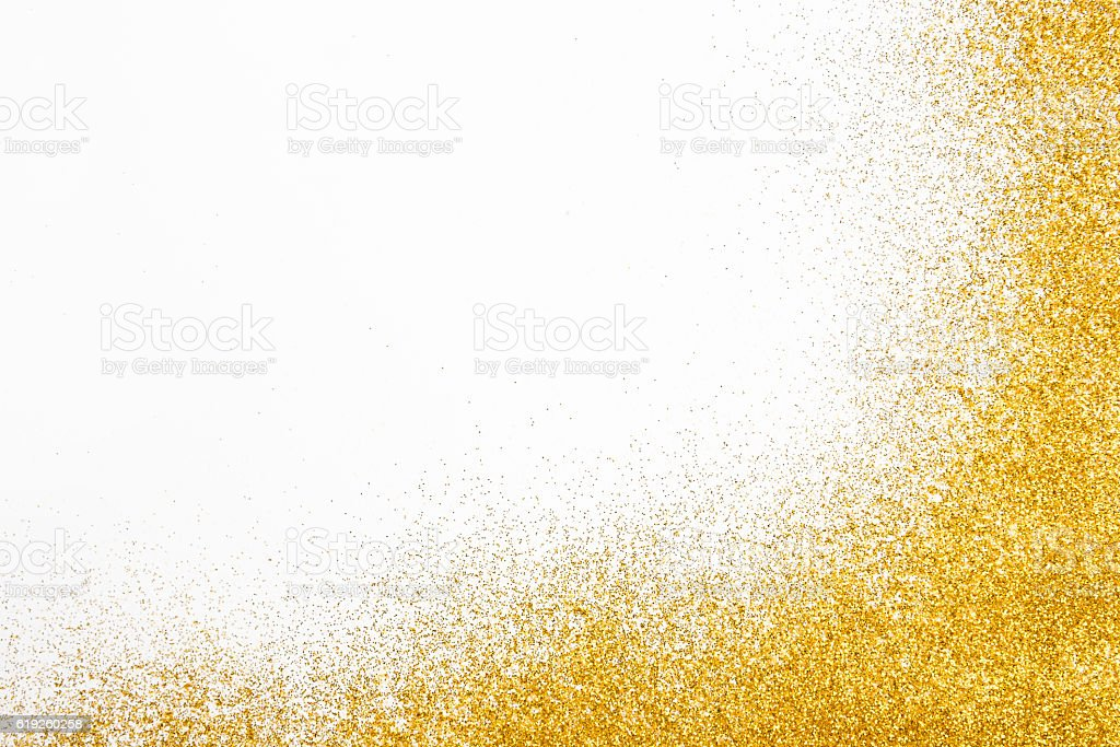 Golden glitter sand texture frame on white, abstract background. stock photo