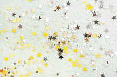 istock Golden glitter stars, abstract christmas background texture 1185300603
