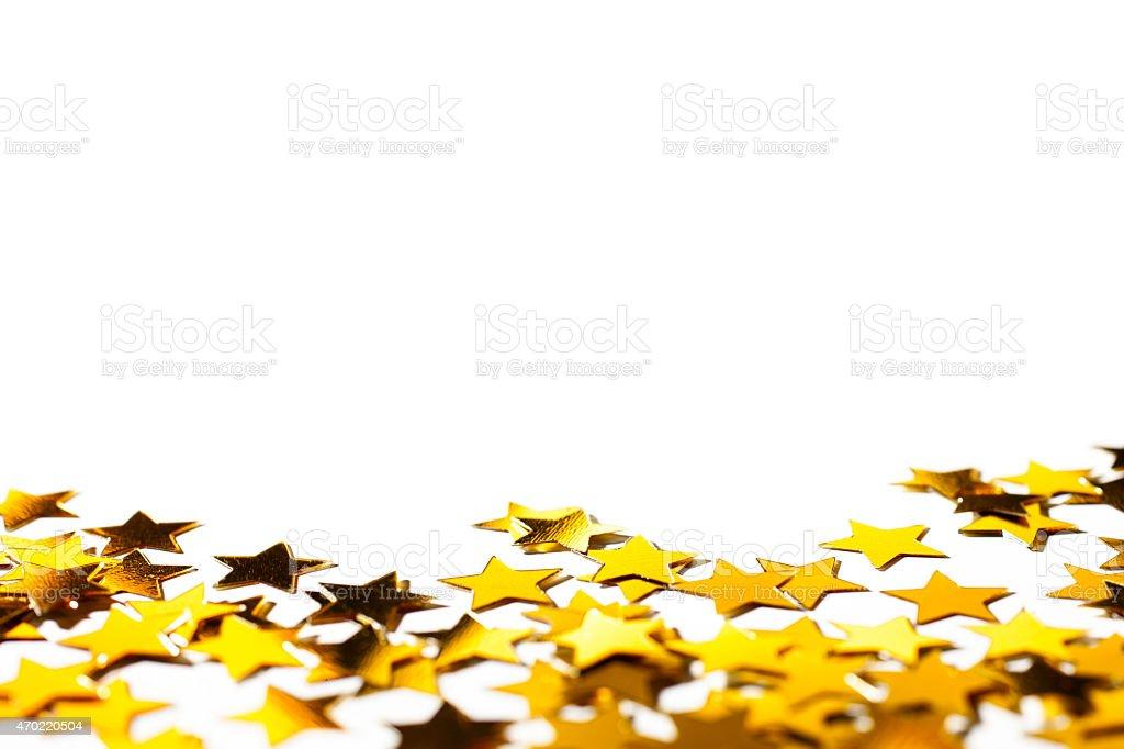 Golden glitter stars on white - Christmas Anniversary Backgrounds stock photo