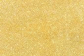 ゴールドのグリッター質感の抽象的な背景