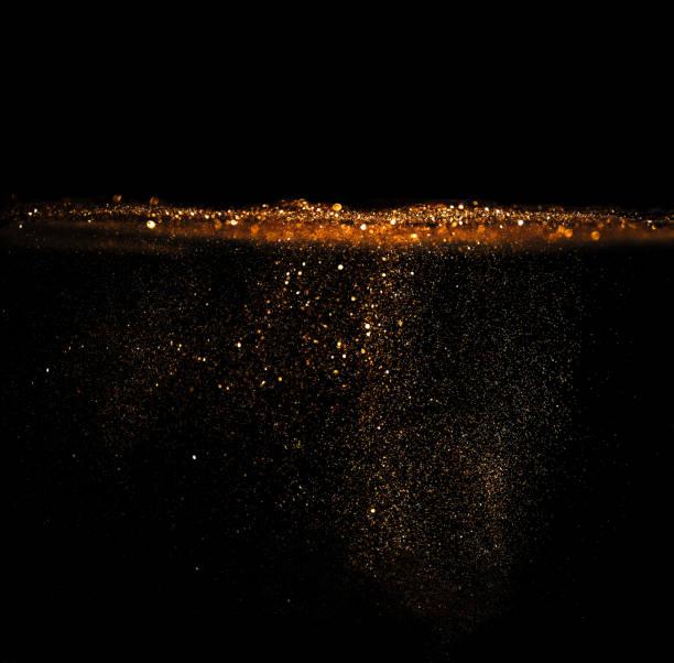 goldene Glitzer Textur Weihnachten abstrakte Hintergrund .defocused. – Foto
