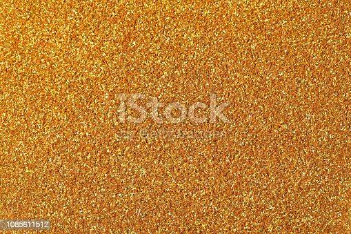 886746424 istock photo Golden glitter texture. High resolution photo of golden glitter background. 1085611512