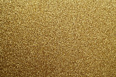 Golden glittering background. Abstract background and texture for design.