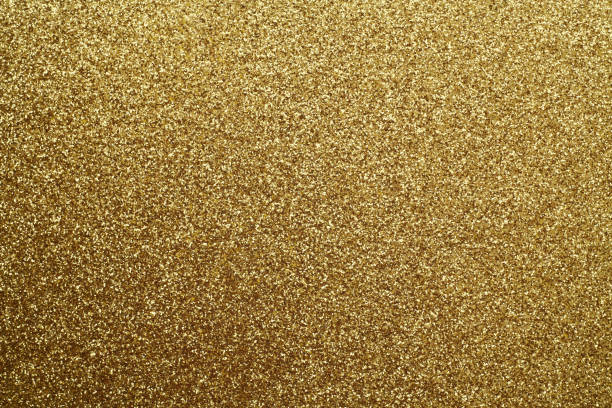 golden glittering background. - scintillante foto e immagini stock