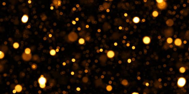 Golden Glittering Defocused Lights Abstract Background stock photo