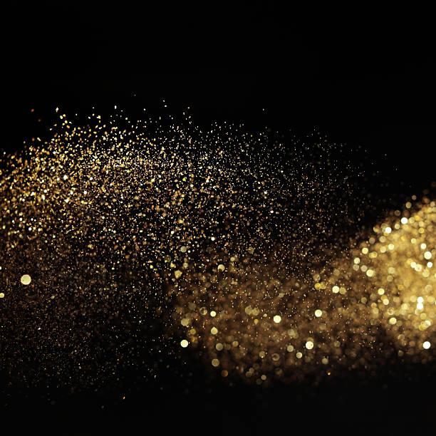 Golden glitzernden leichte, auf schwarzem Hintergrund – Foto