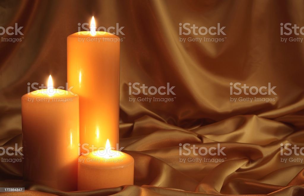 Golden Glow 2 using 3 gold candles and satin royalty-free stock photo