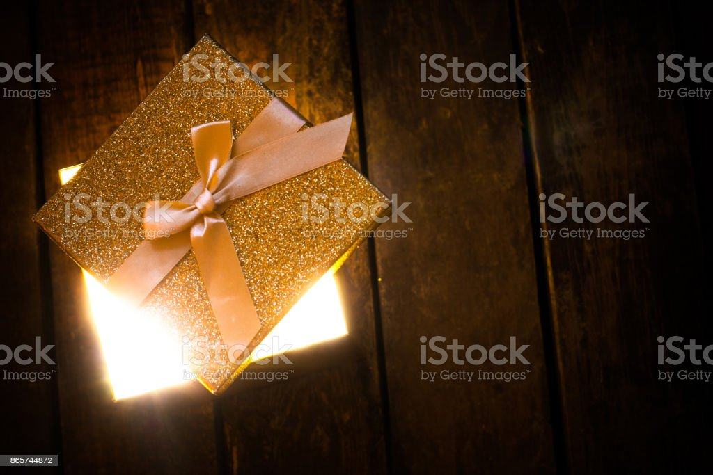Golden glowing box of light stock photo