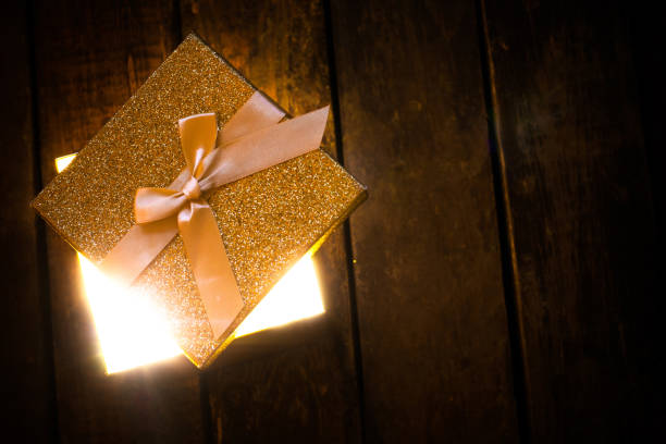 Golden glowing box of light stock photo