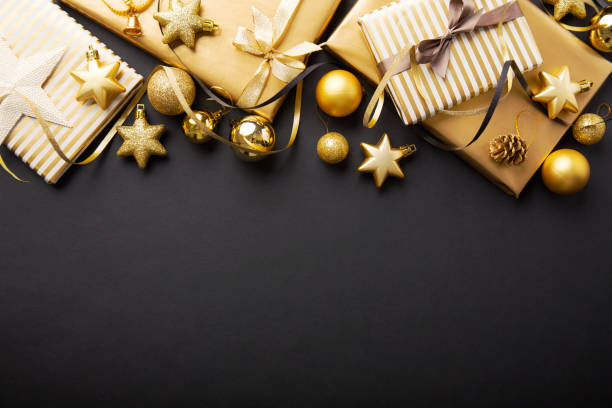 golden golden christmas deco on black - christmas background стоковые фото и изображения