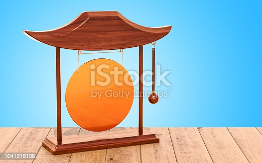 Golden gong on the wooden table. 3D rendering