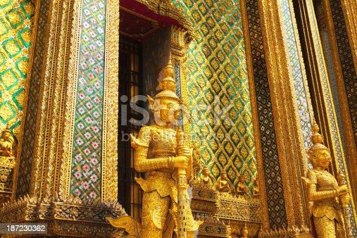 Golden guards at Phra Mondop in Wat Phra Kaeo, Bangkok, Thailand.