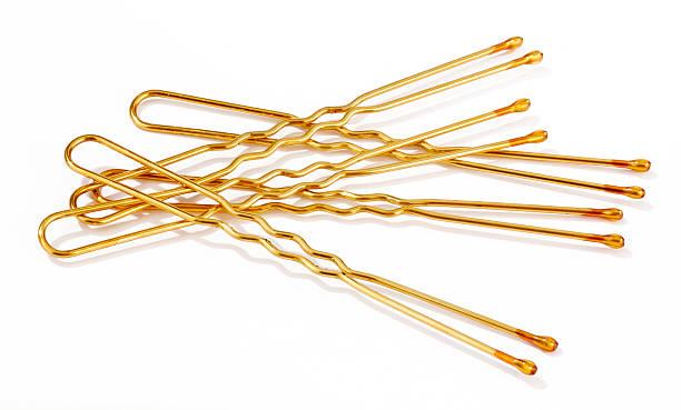 golden hairpins - haarnadeln stock-fotos und bilder