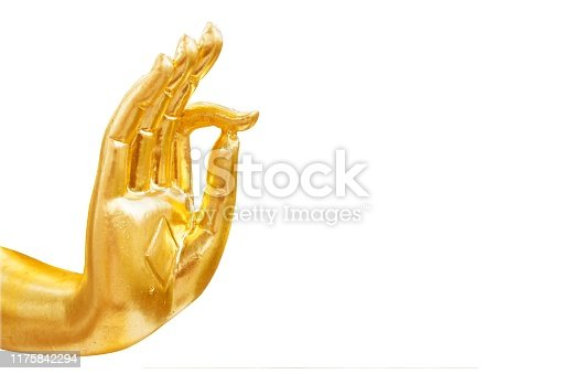 Golden hand of buddha statue isolated on white background