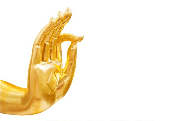Golden hand of buddha statue isolated on white background Golden hand of buddha statue isolated on white background buddha stock pictures, royalty-free photos & images