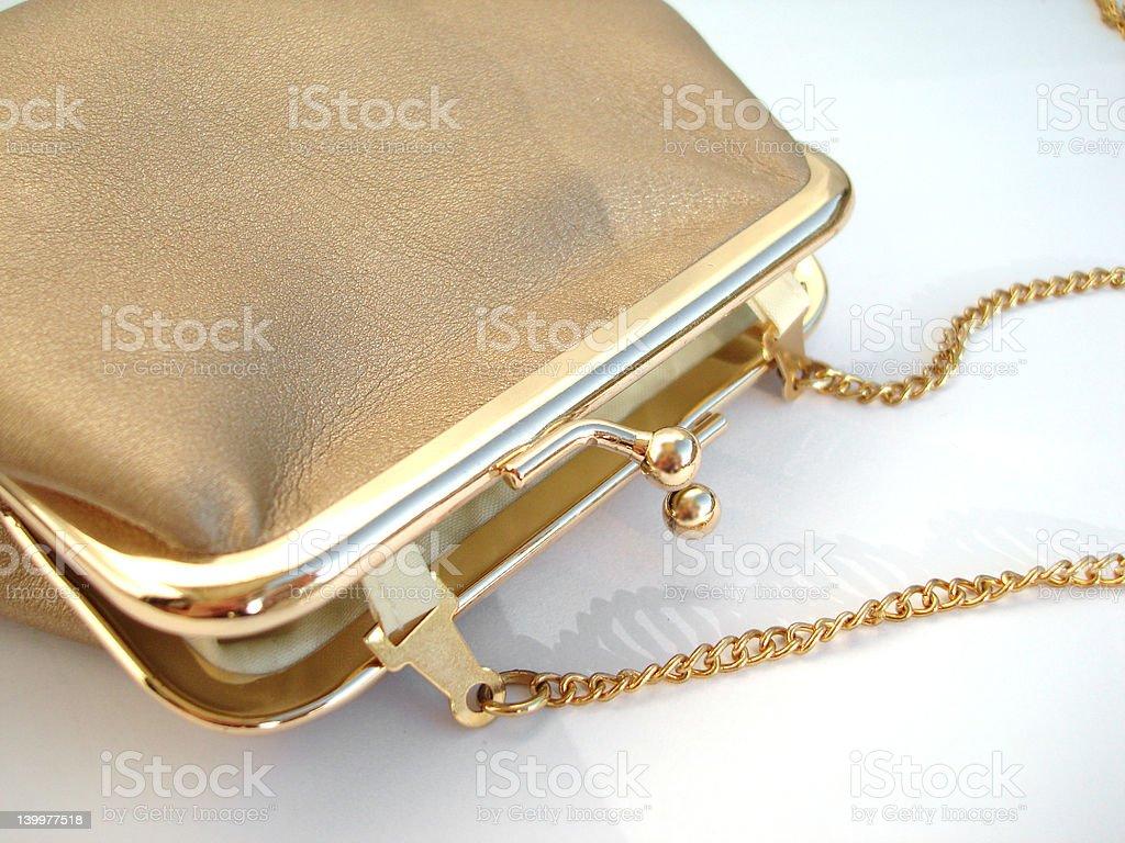 Golden handbag over white background royalty-free stock photo