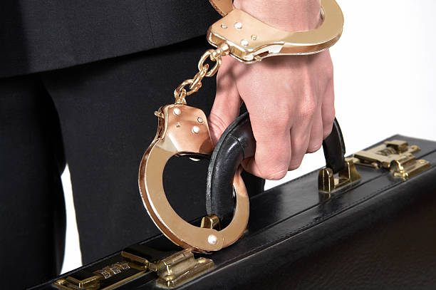 Golden Handcuffs on a Briefcase stock photo