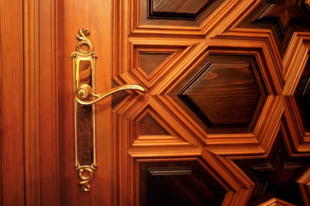 Golden handle on an elegant door stock photo
