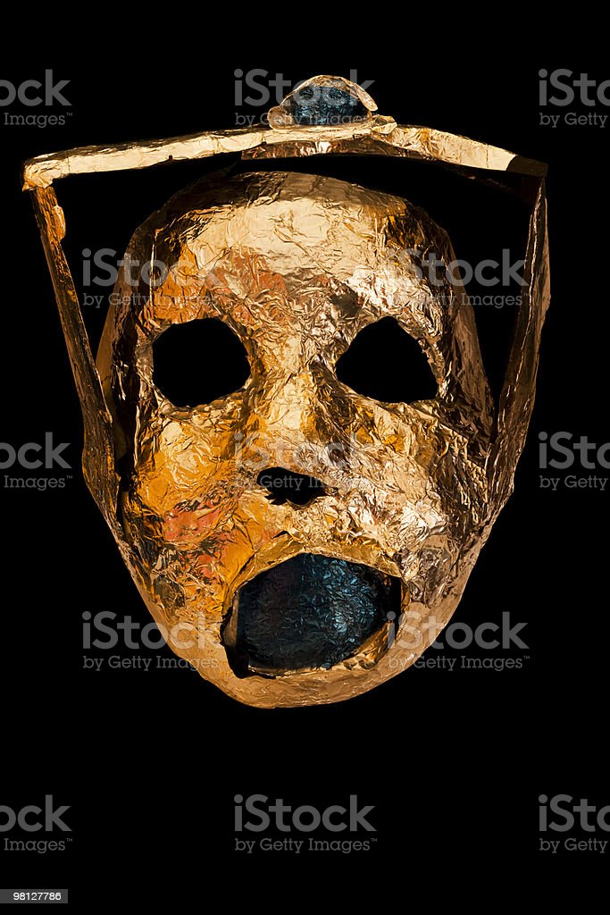 Golden handmade mask of the king, isolated on black background royalty-free stock photo