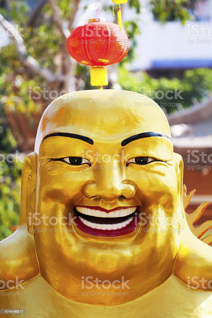 Golden happy and laughing buddha stock photo