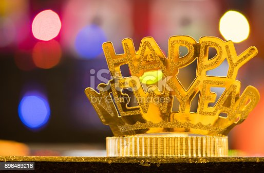 istock Golden Happy New Year headband on colorful bokeh background 896489218