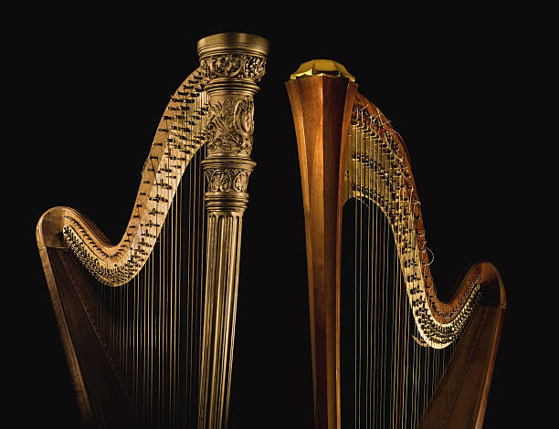 golden harp 2 - harpist stock photos and pictures