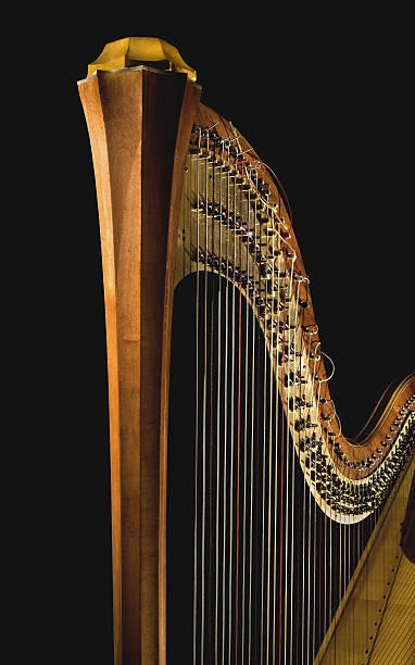 golden harp 4 - harpist stock photos and pictures