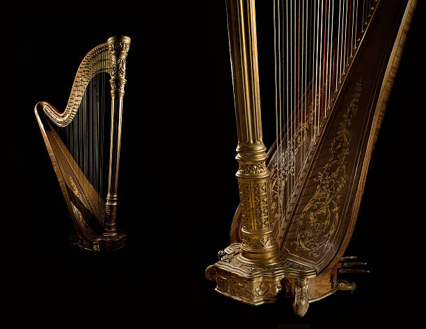 golden harp 8 - harpist stock photos and pictures