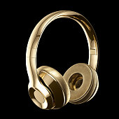 Golden headphones isolated on black