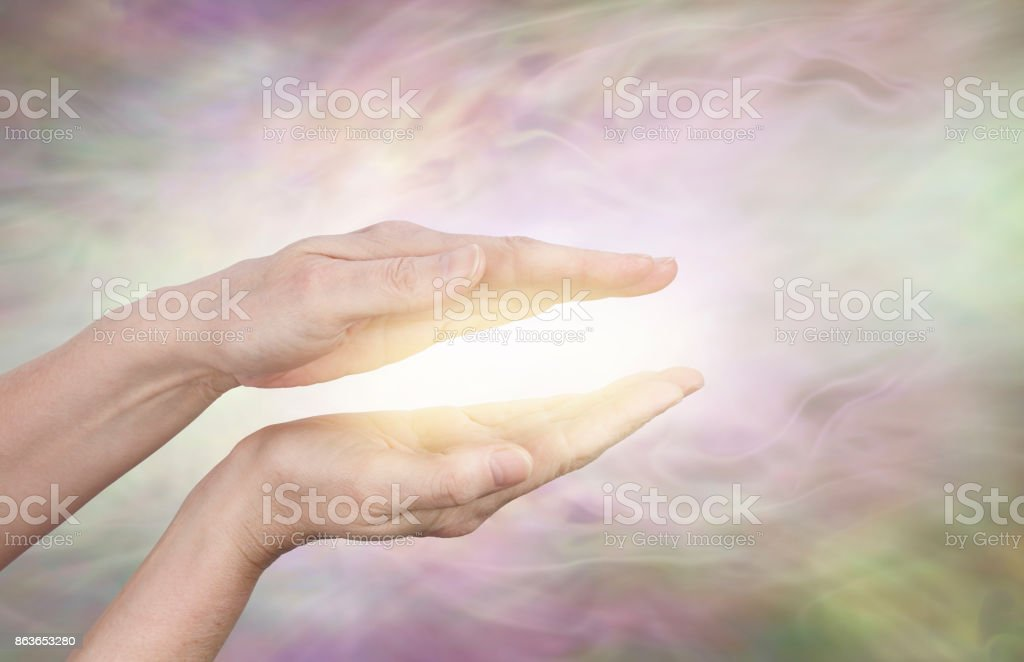 Golden healing aura stock photo