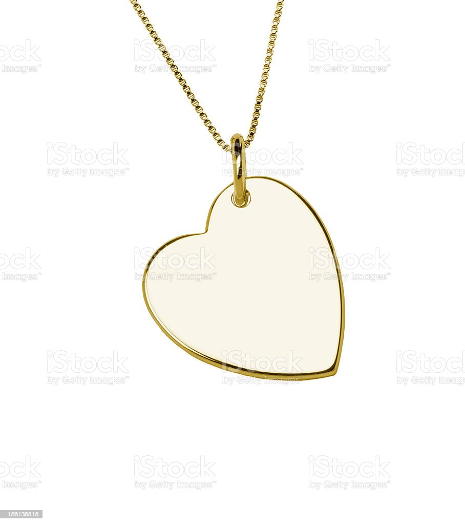 Golden heart pendant isolated on white background stock photo