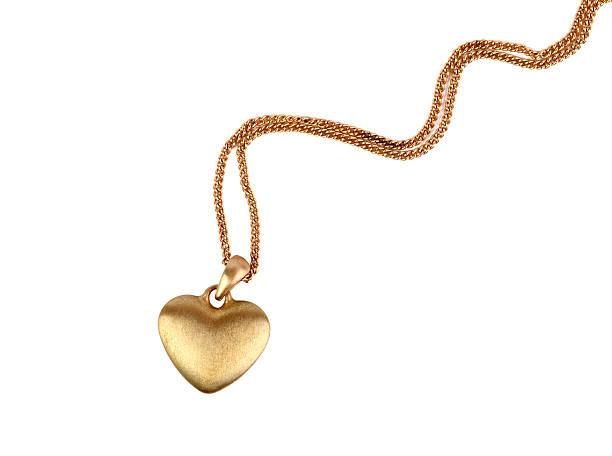 золотой с кулоном в виде сердечка - ожерелье стоковые фото и изображения