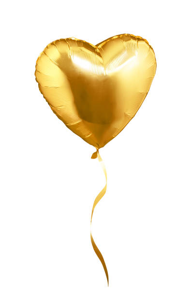 Golden heart shaped air balloon. Isolated on white background stock photo