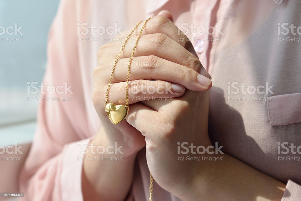 Golden heart with necklace chain stock photo