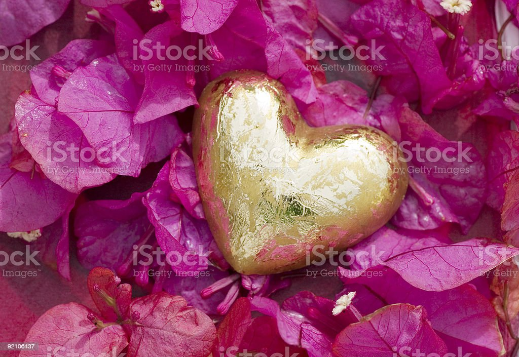Golden heart with pink flowers royalty-free stock photo