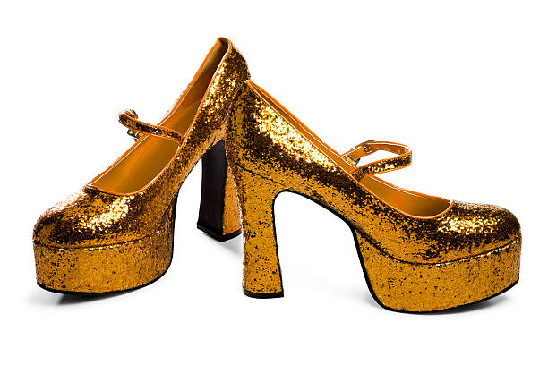 golden high heels isolated on white - disco dancing stock photos and pictures